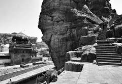 A Muslim community barricaded by Hindu ruins.  #Badami (niveditaagupta) Tags: travel blackandwhite architecture photography karnataka hampi badami hindutemples krishnadevaraya jaintemples chalukyaarchitecture cavearchitecture monolithicconstruction