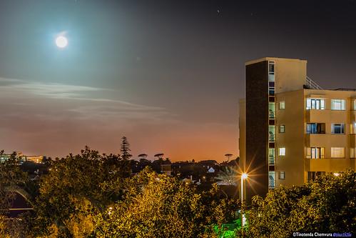 Full moon behind Dullah Omar Hall
