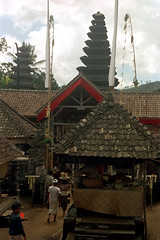 25-291 (ndpa / s. lundeen, archivist) Tags: people bali color building film 35mm buildings indonesia temple pagoda flag traditional nick flags 25 southpacific 1970s hindu 1972 indonesian bamboopole pagodas kehentemple kehen purakehen balinese tileroof dewolf oceania pacificislands penjor nickdewolf photographbynickdewolf reel25