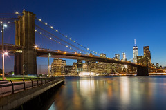Manhattan Sunset (Photos By RM) Tags: nyc newyorkcity longexposure bridge sunset newyork building skyline architecture brooklyn canon lights downtown waterfront skyscrapers manhattan brooklynbridge bluehour newyorkny brooklynbridgepark canonmarkiii