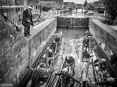 The lock keeper (Anneke Jager) Tags: people blackandwhite monochrome dock zwartwit outdoor lock friesland hindeloopen sluis keeper monochroom kanos annekejager