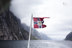 Ferry on Geirangerfjord. (PabloMenndez) Tags: travel sea summer mountains norway ferry landscape cloudy flag traveller fjord geiranger augost