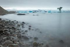 Jkulsrln (GrandJr) Tags: longexposure blue ice water landscape 50mm waterfall iceland still nikon rocks europe waves outdoor 14 ngc glacier nd fx d3 ais hoya izland nd1000 grandjr