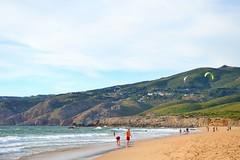 beautiful night (ekelly80) Tags: portugal june2016 summer beach sand water ocean atlanticocean praiadoguincho sun sunset light eveninglight view scenery cliffs beautiful surf kitesurfing night waves footprints