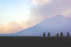 Masaya Volcano (Catherine Marois) Tags: sunset sky cloud mountain nature silhouette canon person volcano smoke tokina land nicaragua masaya 1116 vscocam vscogrid