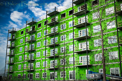 Right between the eyes (HWW) (13skies) Tags: trees windows sky colour green glass living workers construction apartment bright crane balcony insulation bluesky tools highrise labour tall comfort apartmentbuilding slidingdoors hww erecrt happywindowwednesday