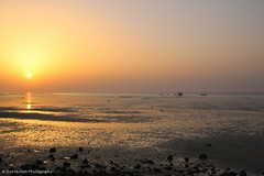 Sundown (Ziad Hunesh) Tags: sunset sea sky sunlight reflection beach canon golden coast tide sigma qatar arabiangulf shamal 650d zhunesh