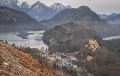 Hohenschwangau (ccr_358) Tags: trees winter panorama lake castle tourism germany landscape lago bayern deutschland bavaria grey see scenery day village view cloudy postcard january lac palace schloss inverno germania cartolina gennaio hohenschwangau baviera alpsee 2016 swabia christmasholidays schlosshohenschwangau hohenschwangaucastle ostallgu ccr358