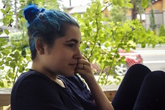 Juliana (lordgogurt) Tags: people person face portrait figure being body life outdoor outdoors sit sitting seated hair blue color colorful profile bun leaves leaf plant plants