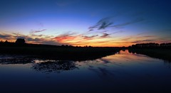 Dusk panorama (M a u r i c e) Tags: dusk sunlight sunset nature water reflections tree silhouettes polder efs1022mm wideangle ultrawidezoom netherlands maarssen sky summer evening
