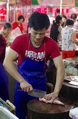 my smiling fish monger (stephen_woolverton) Tags: cantonese market fish monger cleaver clean chopping block