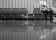 Reading another paper at another quiet spot at another airport. (D_Snapper) Tags: portrait bw white news man black lines self reflections paper reading airport fuji floor bank terminal clean seats fujifilm kuwait marble vloer leest selfie krant vliegveld reflectie stoelen lezen x100 schoon arabtimes x100t sheikhsaadalabdallah