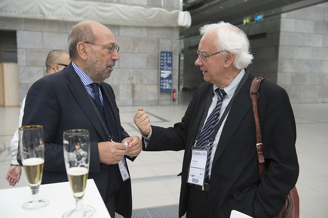 Paolo Costa in discussion at the reception