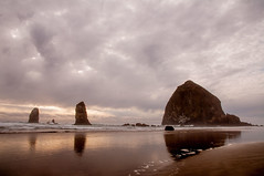 Haystack Rock at Cannon Beach 698 (martinjones1946) Tags: ocean seascape reflection beach rock clouds oregon landscape coast cannonbeach haystackrock monolith martinjones platinumheartaward nikond5000