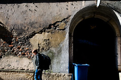 Just Passing by The Wall (prulka) Tags: street old city morning light shadow urban streetart man black guy colors composition contrast dark photography nikon shadows outdoor streetphotography poland capture cracow lightandshadow oldcity contrastive whitness nikonphotography d7100