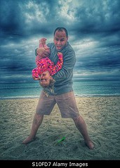 Photo accepted by Stockimo (vanya.bovajo) Tags: family portrait baby playing storm man love beach girl smiling clouds children fun happy togetherness sand toddler funny play father parent together caucasian iphone babyhood iphonegraphy stockimo