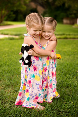 Best Friends Twins (donnierayjones) Tags: girls girl smile sisters toy spring twins hug dress sister twin giggle braids braid