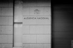 New National Court Entrance (Madrid, Spain) (G.Roca) Tags: madrid street blackandwhite bw white black building court emblem grey official spain sad gray entrance illegal law shield important goverment bureocracy depresive audiencianacional