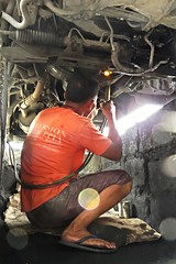 under chassis repair (DOLCEVITALUX) Tags: man car automobile welding labor repair chassis acetylene nder
