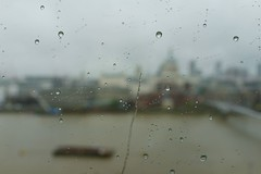 such a cold and rainy day (micmol ) Tags: city uk bridge urban abstract london window water horizontal daylight day rainyday view bokeh outdoor scenic indoor millenniumbridge rainy raindrops daytime riverthames barge stpaulcathedral passerelle overcasted overcastedsky