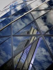 Broken Glass (Douguerreotype) Tags: england geometric glass london uk urban british buildings window city clouds geometry britain architecture reflection gb gherkin