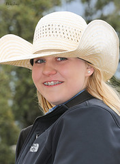 Blonde Cowgirl (wyojones) Tags: woman cute girl beautiful smile hat hair eyes pretty texas braces coat teeth houston parade blonde earrings cowgirl lovely houstonlivestockshowandrodeo cowgirlhat trailrider wyojones houstonlivestockshowandrodeoparade