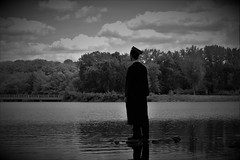 Reflecting Graduate (evan.guest) Tags: school trees bw white lake black reflection college water clouds river high pond university robe gray picture cap thinking graduate moment gown drake grad chords robes congrats grays 2016