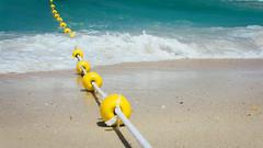 Floats (Bartholomew K Poonsiri) Tags: ocean sea sky beach water yellow seaside dubai uae middleeast wideangle rope float jumeirah persiangulf sonyepz1650mmf3556oss sonyilce6000