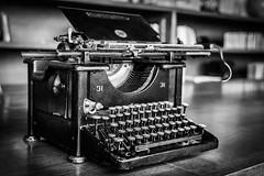 History by a Typewriter (AzazzelPhotography) Tags: old blackandwhite bw black history monochrome typewriter metal 35mm blackwhite nikon keyboard iron oldstyle machine oldschool latinoamerica novel hispanic typing nikonphotography
