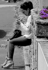 Beautiful lady and blue flowers (patrick_milan) Tags: street people blackandwhite bw white black monochrome noir noiretblanc bretagne nb britanny rue blanc personne streetview gens finistre plouguin
