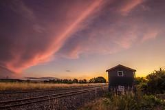 Land of the long crimson cloud? (zebedee1971) Tags: trees sunset sky sun color colour building crimson clouds train landscape dusk tracks railway hut rails kiwirail