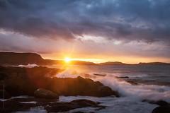 sunset and icebergs at Cape Spear (tuanland) Tags: ocean longexposure sunset sea sky seascape canada beach rock newfoundland landscape evening spring nikon waves stjohns clear shore iceberg signalhill goldenhour nfld atlanticcanada capespear d600 avalonpeninsula newfoundlandandlabrador nikond600