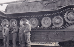 Ferdinand tank destroyer with zimmerit on a train and it's crew.