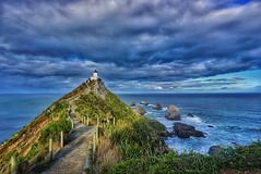 Clouds and ocean along the path to Nugget Point (b_newell92) Tags: ocean travel newzealand lighthouse clouds landscape photography path sony hike wanderlust adventure explore nz drama hdr nuggetpoint amature travelphotography landscapephotography sonyalpha instagram ifttt snapseed sonya6000