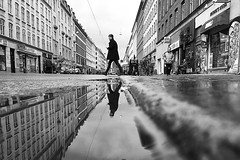 Dressed in black (Birdhouse camper) Tags: street blackandwhite reflection copenhagen denmark puddle blackwhite pov low iphone iphone6s