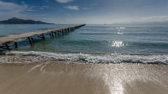 Quiet time (hjuengst) Tags: reflection beach water backlight strand pier spain meer jetty wave sparkle mallorca spanien mediterraneansea majorca steg gegenlicht wellen reflektionen mittelmeer glitzern