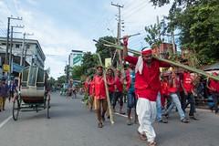 H504_3412 (bandashing) Tags: street trees red england people green manchester watch crowd logs sylhet bangladesh carry mentalhealth socialdocumentary aoa shahjalal bandashing akhtarowaisahmed treecuttingfestival lallalshahjalal