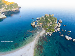 Isola Bella - Taormina - (sverni) Tags: ocean travel blue trees sea summer vacation sky italy panorama cloud white holiday seascape green tourism beach nature water stone landscape island bay coast town spring movement sand rocks mediterranean waves village view place background space flight wave scenary land sicily coastline bella sight phantom taormina copy naxos giardini isola dji mazzar