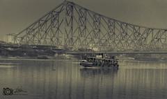 Howrah Bridge and Ferry (Krishanu26) Tags: bridge india architecture landscape nikon dslr capture kolkata lateafternoon westbengal