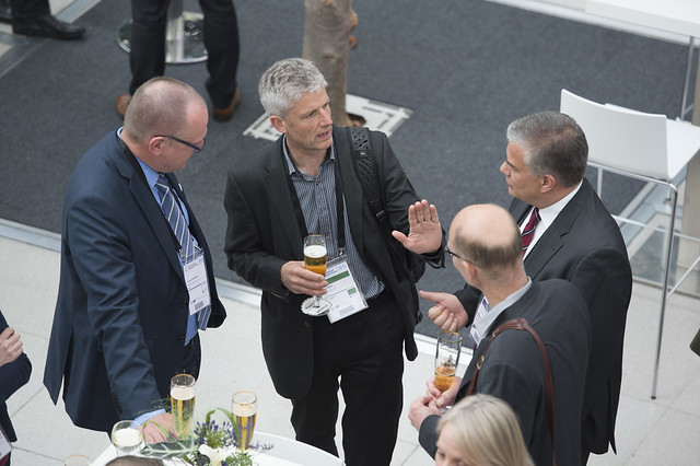 Tomas Svensson, Hans Arby and Jonas Bjelfvenstam enjoying a drink at the reception