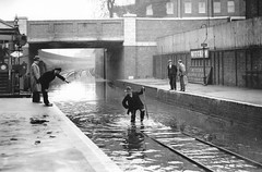 Mitcham  railway station flood 1937. (Ledlon89) Tags: london station train workmen flood transport surrey railwaystation floods 1937 tramlink mitcham britishrailways