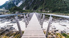 Swing bridge, Hooker Valley Track (KL.Lau  ) Tags: park travel trees newzealand summer sky panorama terrain cloud lake snow mountains tree tourism water grass rock clouds rural forest river landscape outdoors countryside high scenery rocks outdoor hiking sony hill scenic meadow rocky peak scene highland alpine national valley nz mtcook environment wilderness majestic range 15mm tranquil a7 slope ascent geologicalformation voigtlander15mm naturalelevation