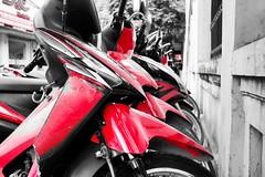 Motorbikes in the millions (Melvin Yue) Tags: street city travel red bw colors monochrome bike 35mm honda blackwhite asia vietnamese cityscape colours streetphotography bikes wanderlust traveller vietnam explore motorbike fujifilm lonelyplanet blacknwhite bnw photooftheday picoftheday natgeo travelphotography selectivecolours travelgram x100s