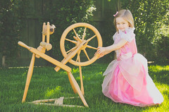"Not So ""Sleeping""  Beauty (LornaTaylor) Tags: copyright2016lornataylor lornataylor taylorimagesca sleepingbeauty child girl pinkdress spinningwheel grass outside smiling sweet fairetale fantasy fairytale story storybook sun outdoors conceptual naturallight spinning antique antiquespinngwheel handmade handmadespinningwheel"