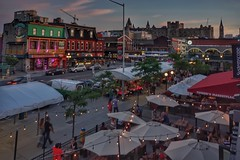 Patio time at Byward Market (beyondhue) Tags: patio byward market umbrella people warm ottawa ontario chateau laurier beyondhue dusk light street architecture building restaurant bar pub tuckers fish marketplace peace tower lamp evening stroll york