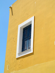 Happy Window Wednesday! (pefkosmad) Tags: blue vacation sky white house holiday window yellow wall wednesday island vacances outdoor hellas greece shutters weathered greekislands griechenland dwelling halki weathering dodecanese