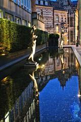 Walking on water (Geoff_B) Tags: sculpture art water pool statue germany dark april bremen 2015
