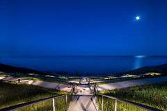 Moon Over Lake Michigan (WRieselbach) Tags: park camera longexposure nightphotography travel blue light sky urban usa moon lake seascape color nature water wisconsin architecture night digital season landscape other spring nikon nightscape outdoor places lakemichigan milwaukee lakeshore moonlight serene