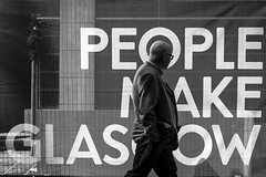 People Make Glasgow (Leanne Boulton) Tags: life street city uk light shadow people urban blackandwhite bw white man motion black detail male texture monochrome sign 35mm canon walking mono scotland living blackwhite natural humanity outdoor expression glasgow candid culture streetphotography streetlife scene human shade 7d juxtaposition society tone timing candidstreetphotography