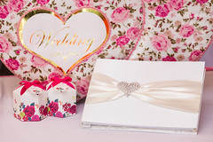 Wedding guest book and wedding box on pink silk (thuvienanh89) Tags: wedding red party two white holiday love beautiful composition silver paper thailand gold book design photo couple day open married heart emotion symbol background album object text ceremony marriage valentine romance read celebration relationship reception together page passion romantic sheet ribbon feeling concept guest elegant curve shape luxury